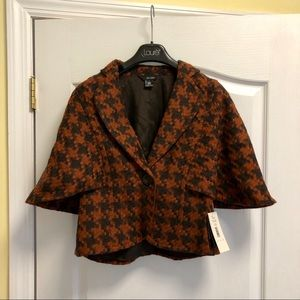 Jacket/poncho w/orange & black houndstooth pattern